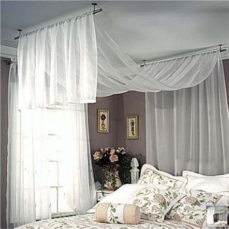how to hang curtains on a canopy bed hang curtain rod from ceiling neiltortorella com