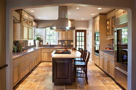 dark island w cream colored cabinets silver hardware tudor house kitchen cabinets tudor kitchen lighting
