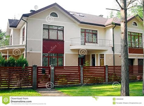 house with fence luxury house with fence and green grass royalty free stock photos image 30959668