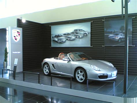 porsche showroom file silver porsche boxster in a porsche showroom jpg