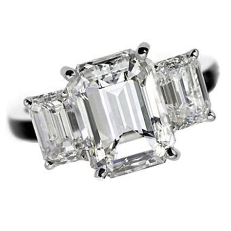 de beers platinum engagement ring with three emerald cut