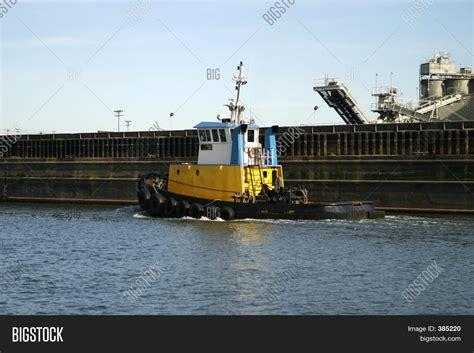 yellow tugboat yellow tugboat image photo bigstock