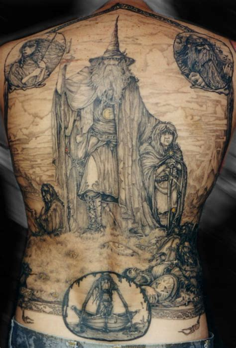 a full back tattoo of an illustrated scene from the lord