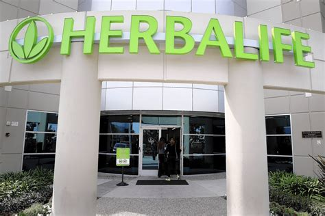 herbalife sede herbalife agrees to pay 200 million settlement and change