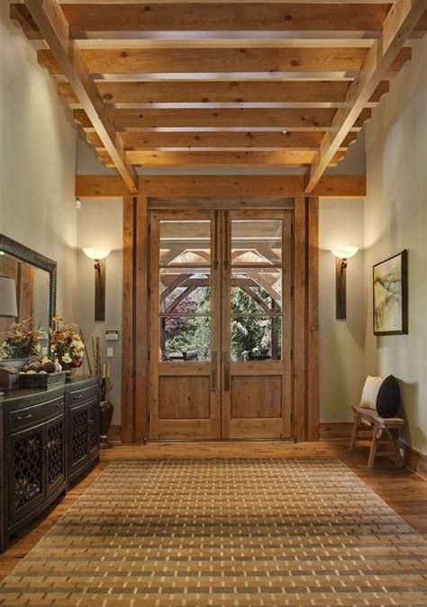 rustic entry  french doors  beams rustic