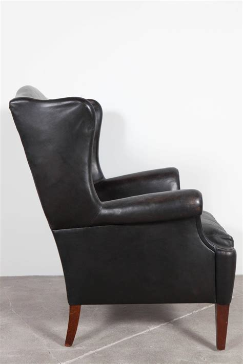 Black Leather Wingback Chair by Black Leather Curved Arm Wing Back Club Chair At 1stdibs