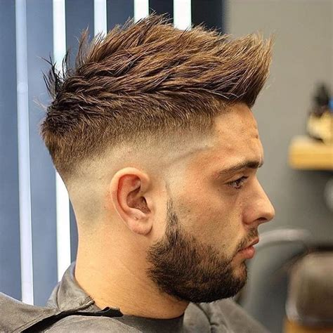textured top faded sides men s spiky textured undercut with faded sides on brown hair