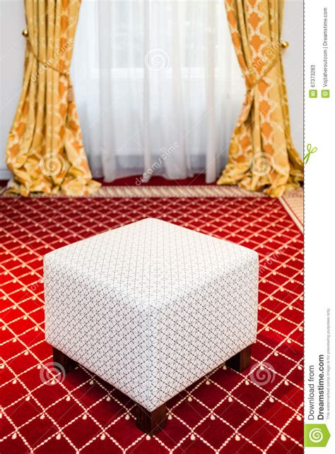 carpet and drapes white pouf in the room with vintage red carpet and yellow