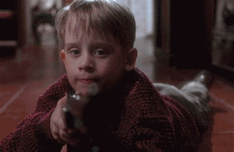 shooting home alone gif find on giphy