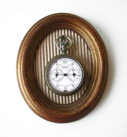 free oval canvas with old watch stock photo freeimages.com