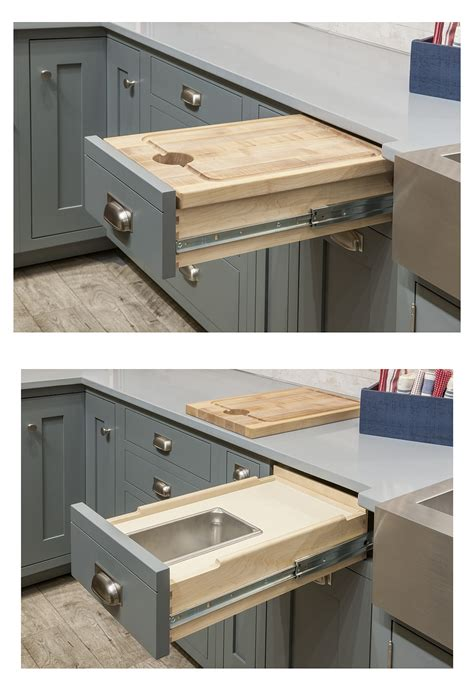 cutting board drawer above trash can organize your cabinets custom cabinets