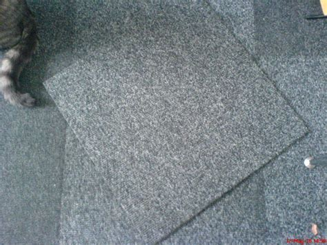 38 Charcoal grey fleck, ribbed carpet tiles. Thick quality