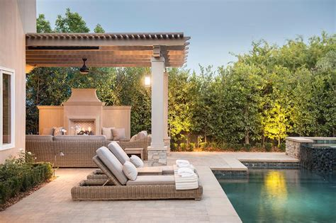 gray pergola over outdoor fireplace transitional pool