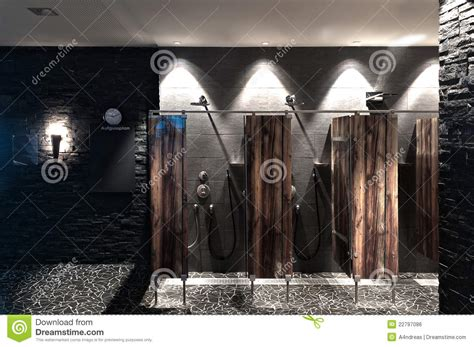 Gray Bathroom Tiles - public showers with wooden divider wall and dark t royalty free stock image image 22797086
