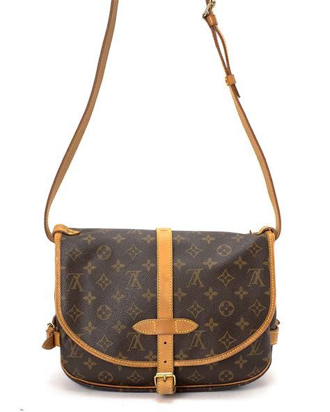 lyst louis vuitton monogram saumur  shoulder bag  brown