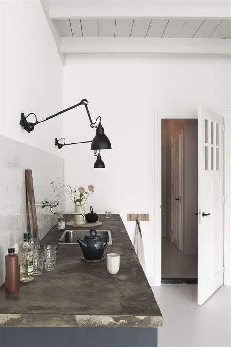 black wall mounted task lighting in the kitchen black