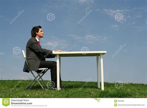 Sitting At Desk by Sitting At Desk Outdoors Royalty Free Stock Photos