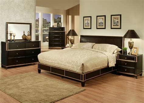 black wooden bed with headboard and beige bedding set on