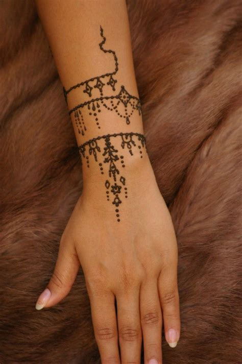 henna tattoo hand wei the 25 best wrist bracelet tattoos ideas on