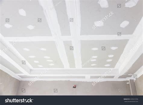 build gypsum board ceiling construction site stock photo