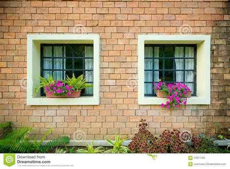 windows in a house exterior and windows of a beautiful old house stock photo image 57871165