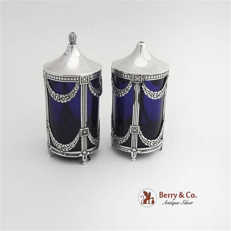 the original salt company l salt and pepper shakers sterling silver cobalt blue glass