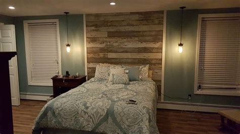 used laminate flooring that looked like reclaimed barn wood headboard wall pinterest