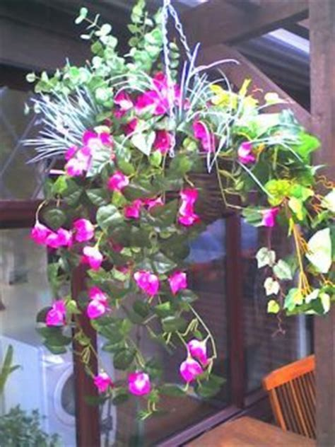 78 ideas about hanging pots on pinterest hanging pans how to make a hanging basket with artificial silk flowers