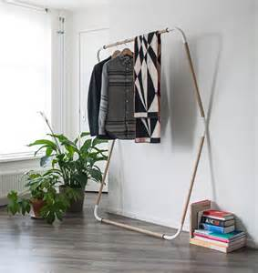 out of closets leaning rack hangs clothes in small spaces