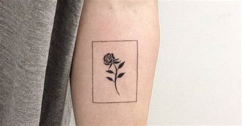 tattoo minimalistisch black rose tattoo on the inner forearm