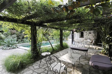 pergola pool view with cast iron furniture interior