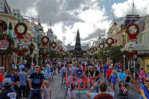 christmas decorations go up at the magic kingdom wdwtools