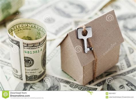 buying a house cash or mortgage model cardboard home key and dollar money house building