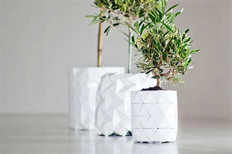 Plant Origami - this origami pot grows along with a plant s roots co