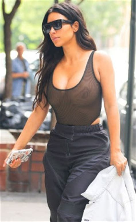 kim kardashian seen wearing a sheer top without bra