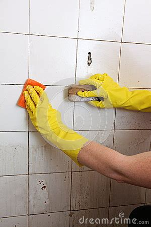 cleaning dirty bathroom tiles cleaning of dirty old tiles in a bathroom royalty free