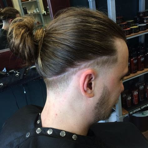 fadeout top knot 15 man bun hairstyles how to be manly with a top knot