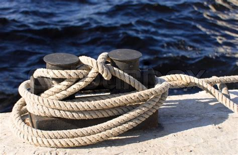 boat dock ropes boats and docks to which ropes are tied stock photo