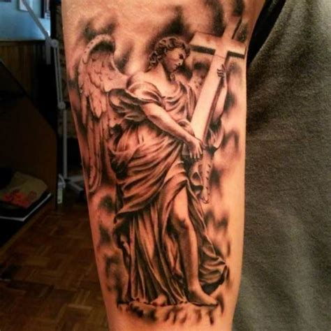 religious angel tattoo designs religion of with cross tattooed