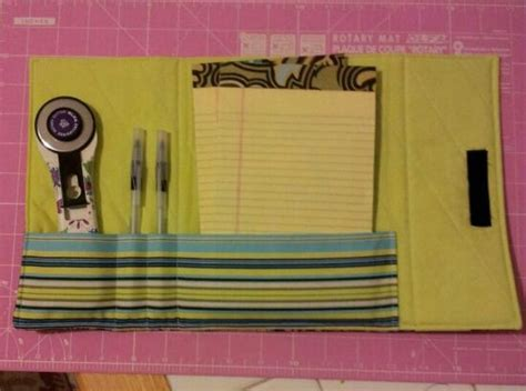 sewing pattern magazine holder inside of notebook holder the rotary cutter is to show
