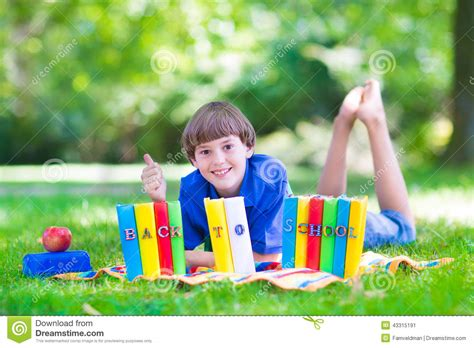 thumbs up my brown boy books happy boy going back to school stock photo image 43315191