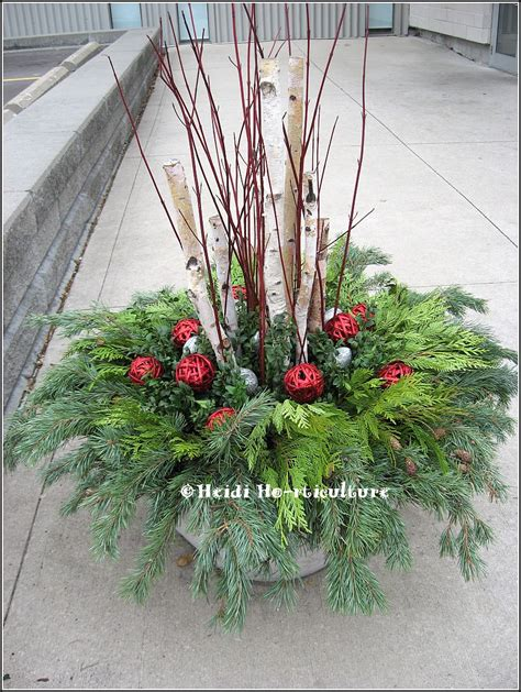 christmas decorating huge stone urns in front of entrance heidi horticulture outdoor container large planter