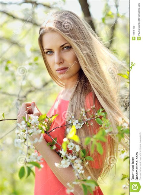 beautiful woman by the tree looking up stock photo image young woman is standing near the tree stock image