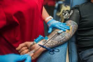 can you donate blood with a tattoo cross myth busters the facts on tattoos and giving blood