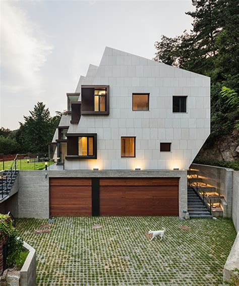 buy a house in south korea poly m ur carves a slanted form for deep house in south korea