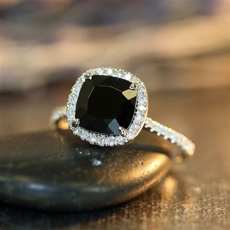 black spinel halo engagement ring in 14k by