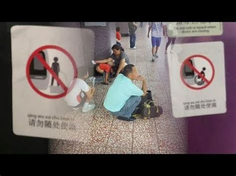 how to poop in public bathrooms subway signs warn chinese tourists not to poop in public