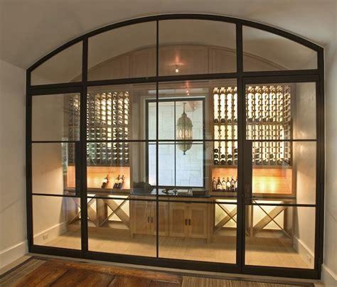 glass door wine storage wine cellar transitional basement and
