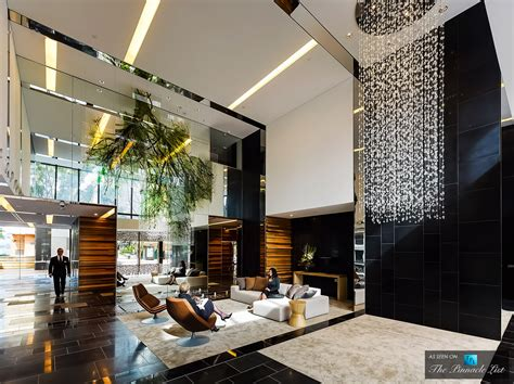 the sunlit lobby of the luxury hyde apartment building in sydney australia commercial