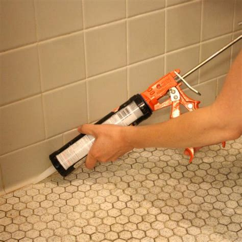 re caulking bathroom tub learn how to re caulk your bathroom how tos diy recaulking